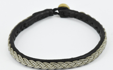A LEATHER BRAIDED BRACELET