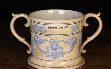 A Large 19th Century Loving Mug sprigged with pale blue glazed relief moulded decoration and impress