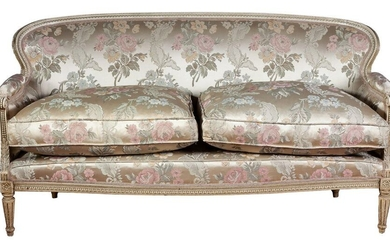 A Louis XVI style white lacquered silk upholstered sofa