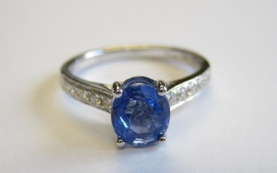 A Sapphire and Diamond Ring claw-set oval-cut sapphire, 1.24cts,...