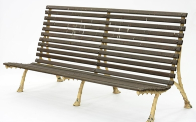 A VICTORIAN STYLE GARDEN SEAT WITH RUSTIC CAST IRON ENDS AND...