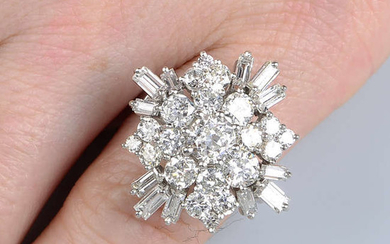 A circular and baguette-cut diamond dress ring.
