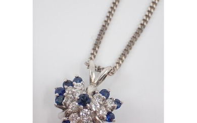 A diamond and sapphire set pendant on a chain
