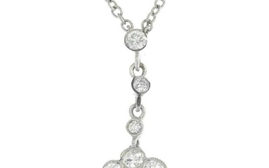 A diamond floral pendant, suspended from an integral