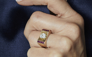 A diamond, red stone, platinum and gold ring, circa 1940....