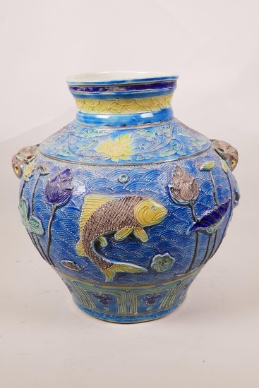 A large Chinese blue ground jar with two mask handles, the b...