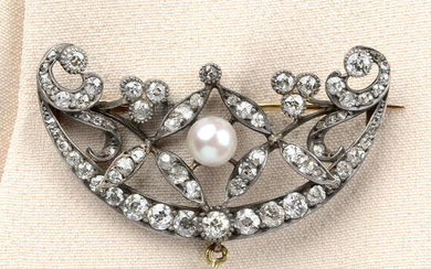 A late Victorian silver and gold, old-cut diamond and pearl crescent brooch.