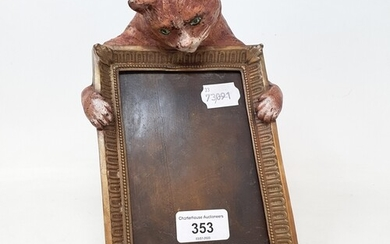 A painted bronze photograph frame, mounted with a ginger cat...