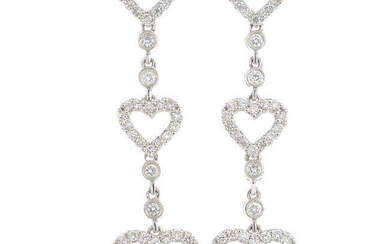 A pair of 18ct gold diamond drop earrings.
