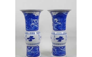 A pair of Chinese blue and white porcelain Gu shaped vases d...