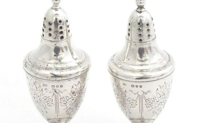 A pair of silver peppetettes of urn shape of square