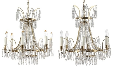 A pair of small Swedish six-light chandeliers with brass frames. Electrical. Empire style, late 20th century. H. (ex. chain) 65 cm. Diam. 57 cm. (2).
