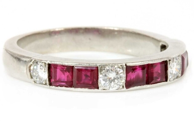 A ruby and diamond half eternity ring