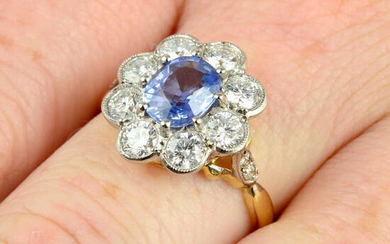A sapphire and brilliant-cut diamond floral cluster ring.