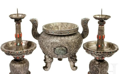 A three-part Sino-Mongolian silver altar set, adorned