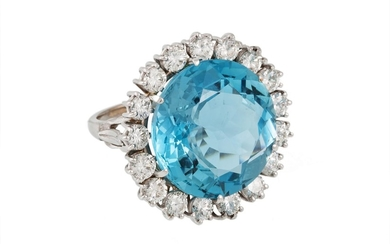 AN AQUAMARINE AND DIAMOND CLUSTER RING, the large circular a...