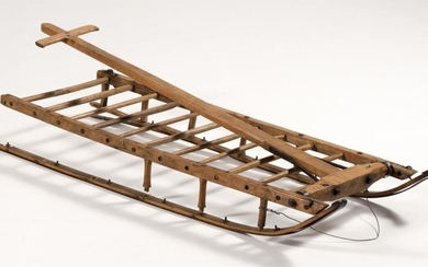 """ANTIQUE WOOD AND WROUGHT IRON SLED Unmarked. Length 49"""". Width 16.5""""."""