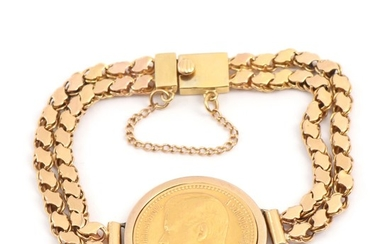 An 18k gold bracelet set with Russian 15 roubles 21k gold coin from 1897 in a 1k gold setting. L. 19 cm. Weight app. 32.5 g.