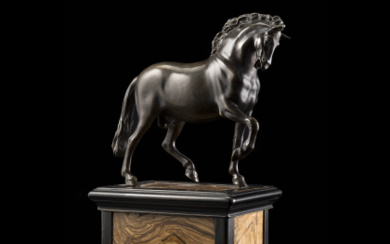 An antique bronze horse on a ebonised wooden and...