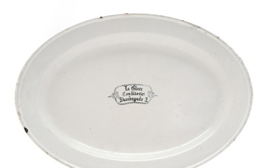 An oval enamelled dish made for the Pattiseerie La Glace in Copenhagen. Mark of Glud & Marstrand. L. 46 cm.