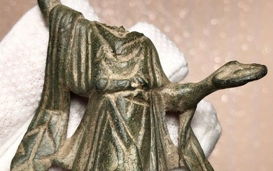 Ancient Roman Bronze Lovely Torso Figurine of the domestic Deity Lares wearing an Opulent Chiton and holding a Patera.