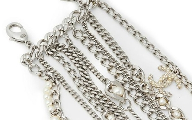 Chanel - a multi-chain and imitation pearl bracelet.