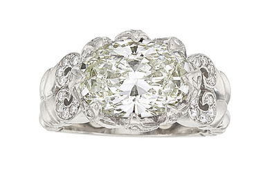 Diamond, Platinum Ring The ring features an oval-shaped diamond...