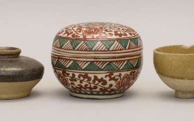 FIVE PIECES OF ASIAN CERAMICS A Ming celadon stoneware jarlet, a celadon stoneware footed cup, a Liao stoneware jarlet, a Sawankhalo...