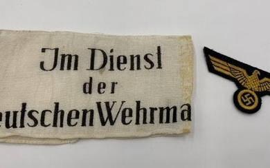 GERMAN WWII ARMBAND AND INSIGNIA