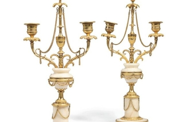 Pair of gilt bronze torches with two light arms made...