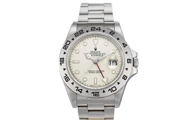 ROLEX | EXPLORER II, REFERENCE 16550, A STAINLESS STEEL DUAL TIME ZONE WRISTWATCH WITH DATE, CREAM RAIL DIAL AND BRACELET, CIRCA 1988