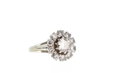Ring in 18 K (750 °/°°) white gold set with a diamond of about 0.60 ct, in a setting of ten old cut diamonds.