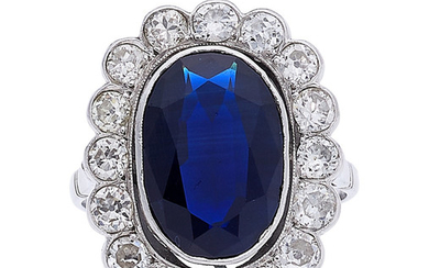 Sapphire, Diamond, Platinum Ring The ring features an oval-shaped...