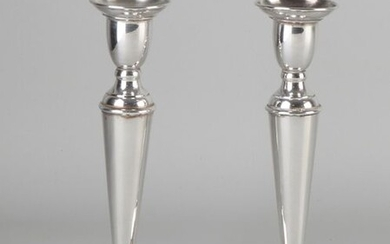 Set silver candlesticks, 925/000, on a round base decorated with a filet edge. Importer's mark: Rikkoert Schoonhoven. 9x18cm. In good condition