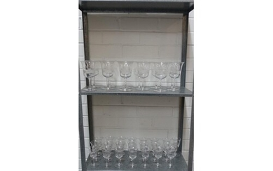 Suite of drinking glasses with etched monogram and facet cut...