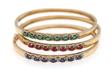 Three bangles respectively set with emeralds, sapphires, rubies and diamonds, mounted in 14k gold. L....