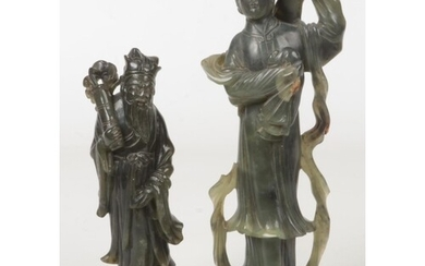 Two Chinese nephrite figural carvings. One formed as Guanyin...