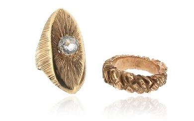 Two gold rings, one navette-shaped gold ring with...