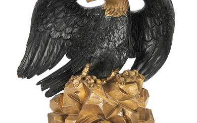 A 19th century carved, painted and giltwood bed corona formed as an eagle