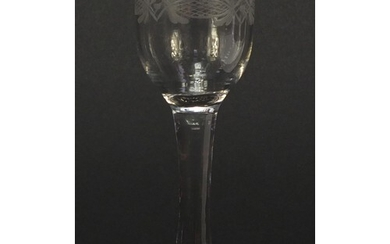 18th century wine glass with engraved bowl and folded foot, ...