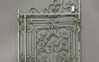 A 19th century green painted wrought iron single gate of scrollwork form, height 170cm, width 87cm.