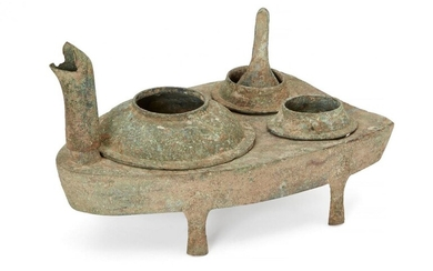 A Chinese bronze zoomorphic stove, Han dynasty, modelled as a...