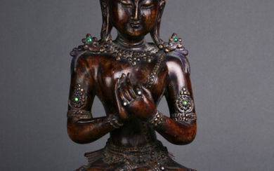 A Chinese wood sculpture of Bodhisattva