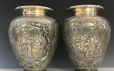 A MAGNIFICENT PAIR OF PERSIAN SILVER VASES