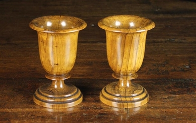 A Pair of 19th Century Turned Olive-wood Goblets. The deep bowls with flared rims above short blade