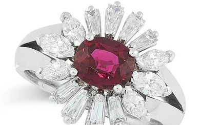 A RUBY AND DIAMOND CLUSTER RING set with an oval cut