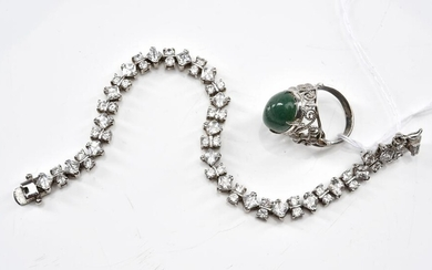 A STONE SET LINE BRACELET IN STERLING SILVER, TOGETHER WITH A QUARTZ RING IN SILVER