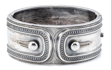 A VICTORIAN STERLING SILVER HINGED CUFF BANGLE; 3cm wide with applied cuff and link design, hallmarked Birmingham 1882, internal cir...