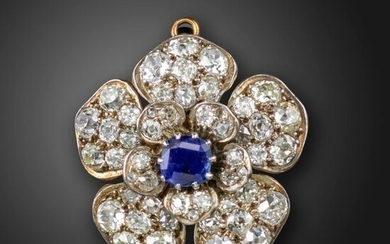 A Victorian sapphire and diamond flowerhead brooch pendant, centred with a cushion-shaped sapphire, the petals set with graduated old cushion-shaped diamonds in silver on gold, folding pendant loop, 3.5cm wide