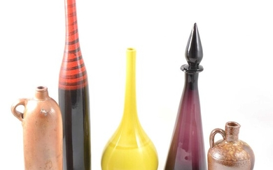 A collection of stoneware bottles, and contemporary glass vessels